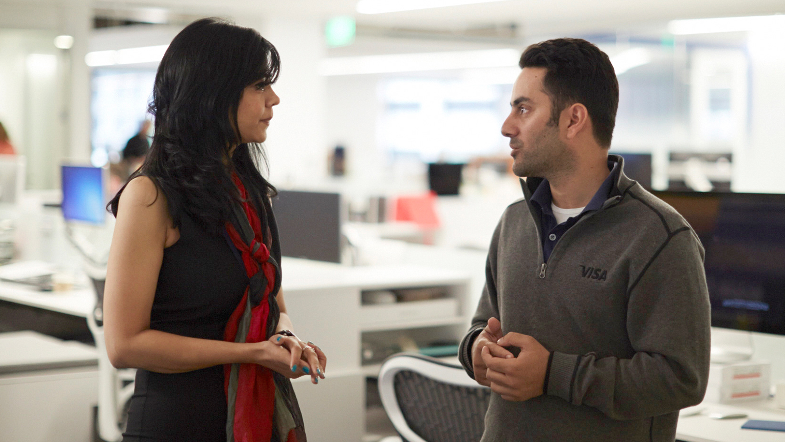 Woman and man discussing topic in office